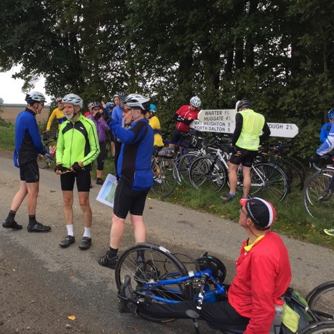 "Wheelers pause to view the loaction of ""Less Trees Near Warter"""